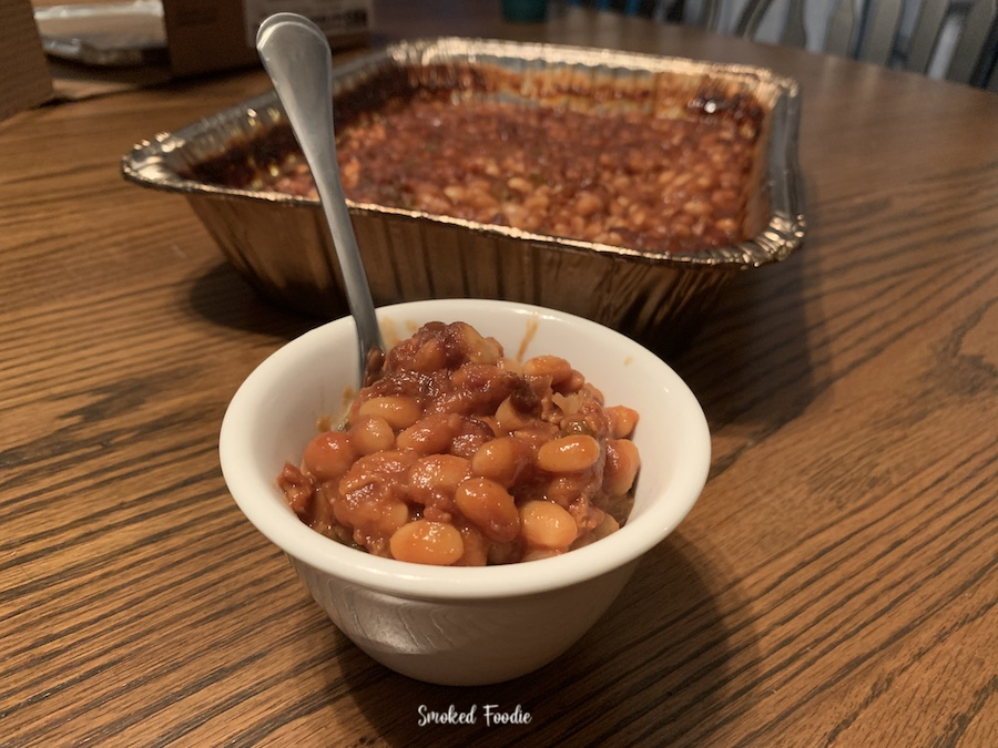 Another horizontal view of the finished smoked baked beans in a dish ready to eat.